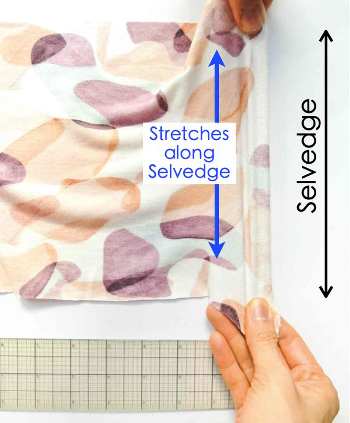 Shows hands pulling on 4 way stretch knit in vertical direction