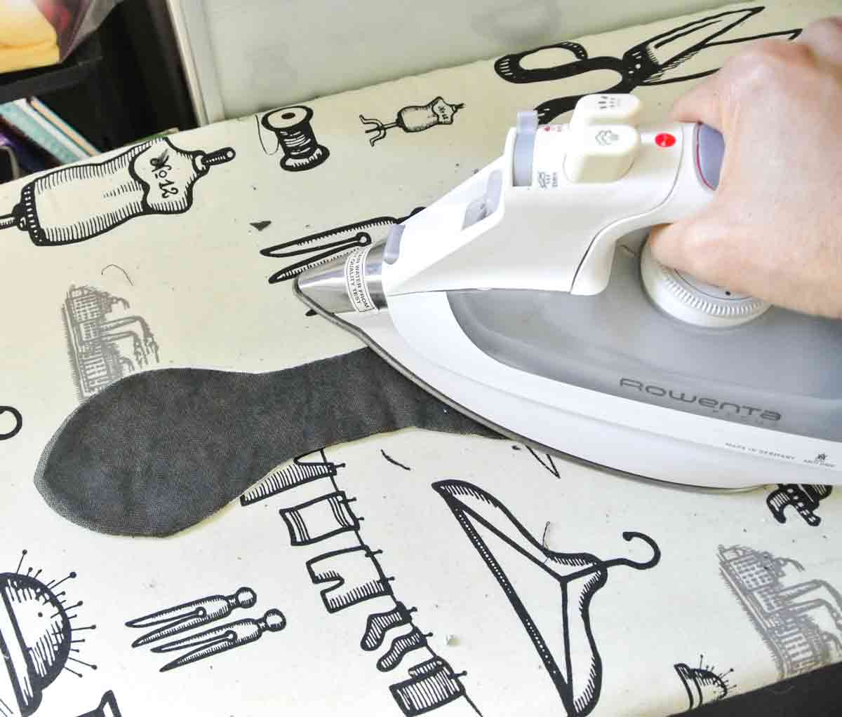 Ironing fusible to wrong side of bow. How to make bow tie for headband