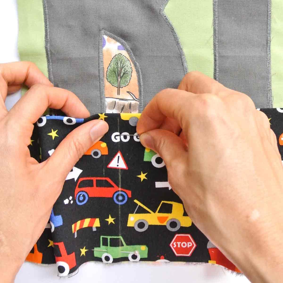 Pinning Pockets Piece to Play Mat