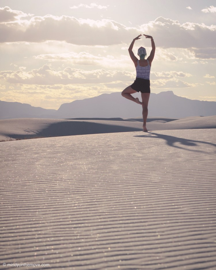 photo of girl in white sands national park at sunset