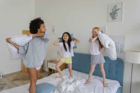 diverse girls playing in bedroom