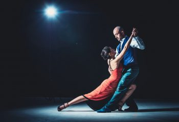 woman-and-man-dancing-under-light-2188012