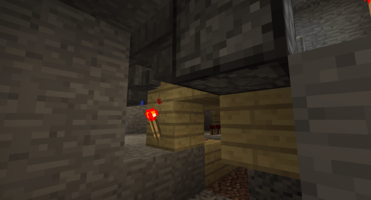 The lower redstone signal will turn this redstone torch off just a split second after the dispenser has filled the empty bucket with water, allowing the water bucket to be drawn into the hopper under the dispenser and pass through another hopper into a vertical dropper chain.