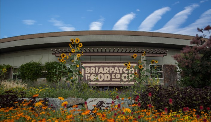 Briar Patch Food Co-Op exterior with flowers