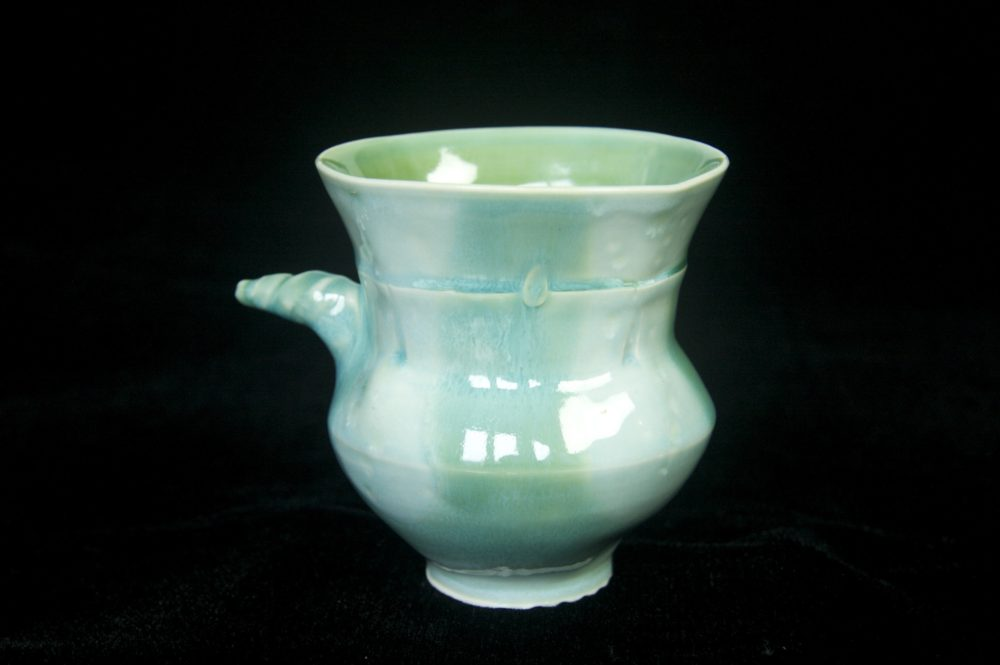 Pigtail mug in ice blue and green celedon. Porcelain