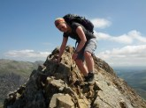Happily clambering over the summit of Crib Goch