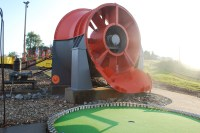 Golfers had to putt through the rotors of this working mine fan
