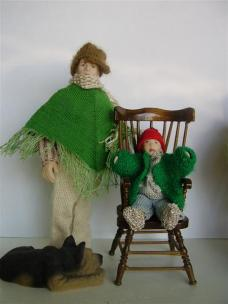 The green poncho is knitted from the neck down.
