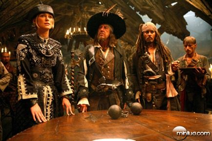 Pictured L-R: Elizabeth Swan (KEIRA KNIGHTLEY), Captain Barbossa (Geoffrey Rush), Captain Jack Sparrow (Johnny Depp), and Ragetti (MAKENZIE CROOK) in a scene from PIRATES OF THE CARIBBEAN: AT WORLD'S END, directed by Gore Verbinski and produced by Jerry Bruckheimer, from a screenplay written by Ted Elliott & Terry Rossio.