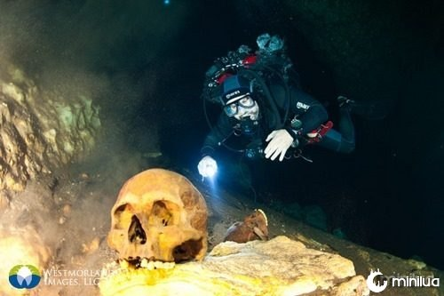 Team divers inspecting and filming Mayan remains of sacrifices in San Antonio Cenote