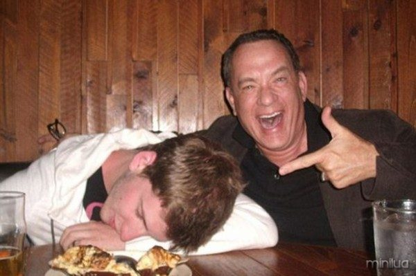 TOM HANKS POSES WITH A DRUNK FAN
