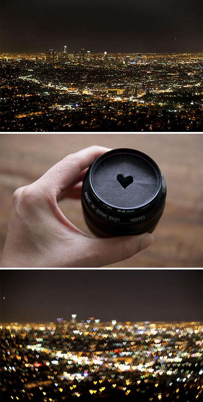 Cortar uma forma de coração em um cartão para um Bokeh em forma de coração