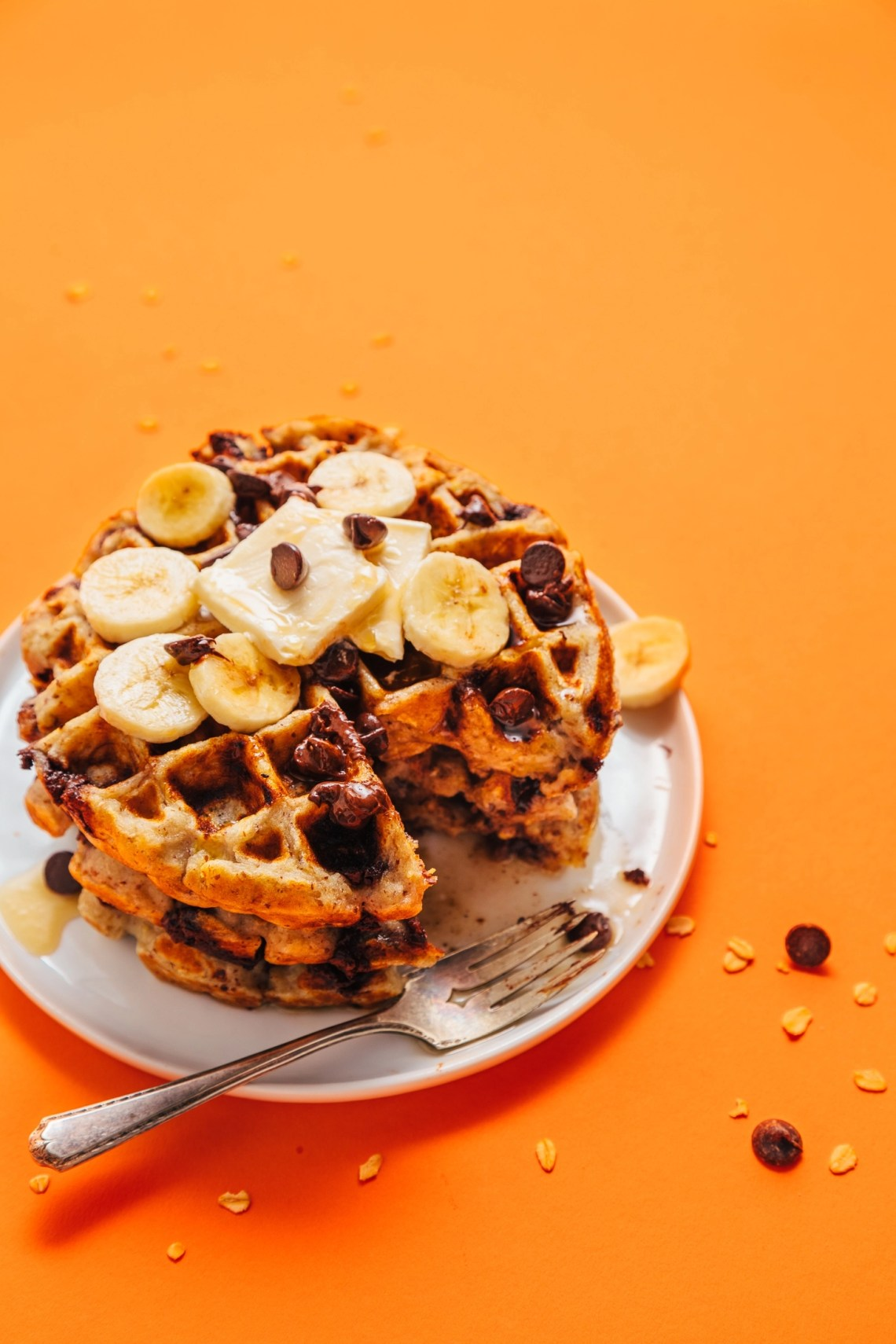 Stack of Chocolate Chip Banana Bread Waffles with a bite cut out