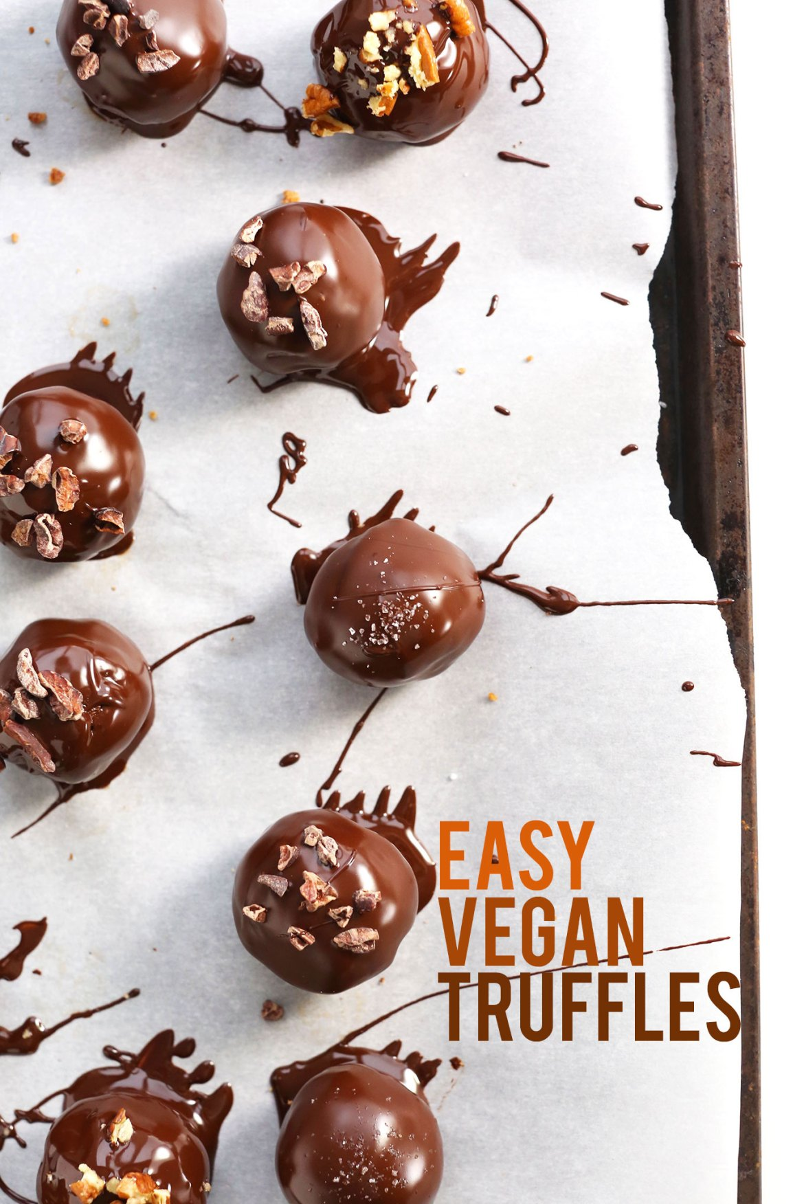 Easy homemade Vegan Chocolate Truffles on a parchment-lined baking sheet