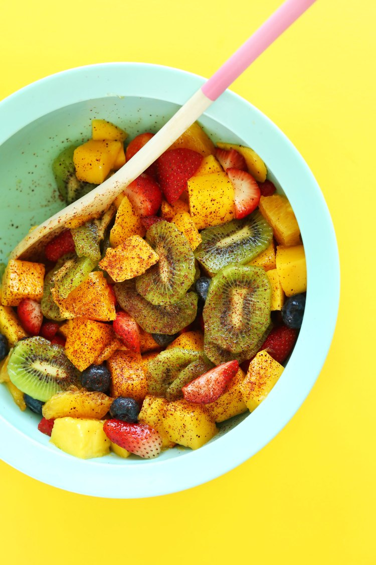 AMAZING Fruit Salad with lime juice and chili powder for a kick of heat! This stuff is IRRESISTIBLE! #vegan #glutenfree #recipe #fruit #healthy #sidesalad #minimalistbaker