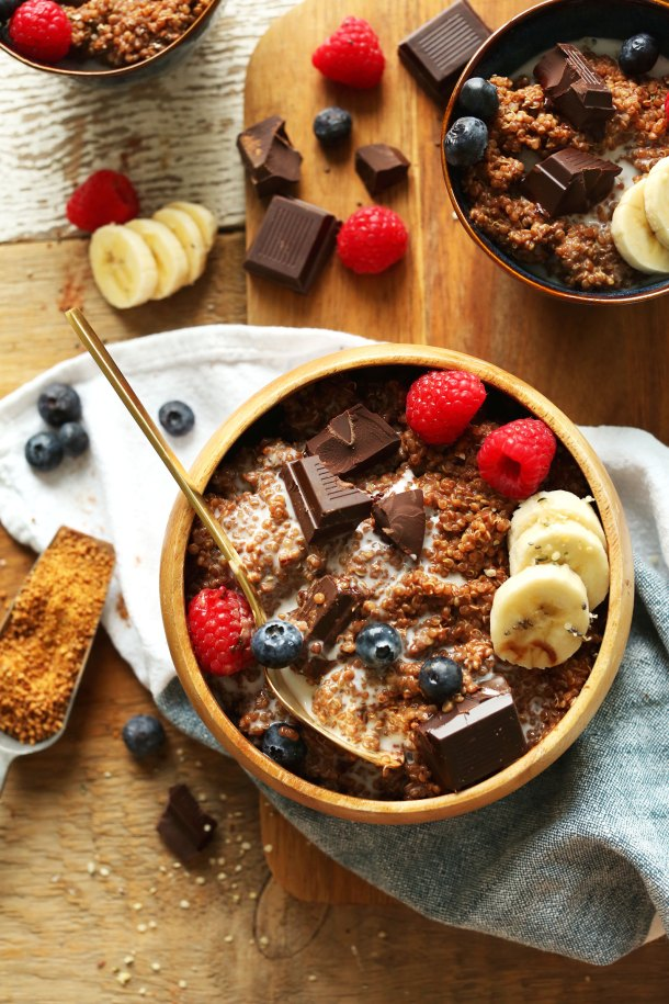 Grabbing a bite of our Dark Chocolate Quinoa Breakfast Bowl with fresh berries and banana