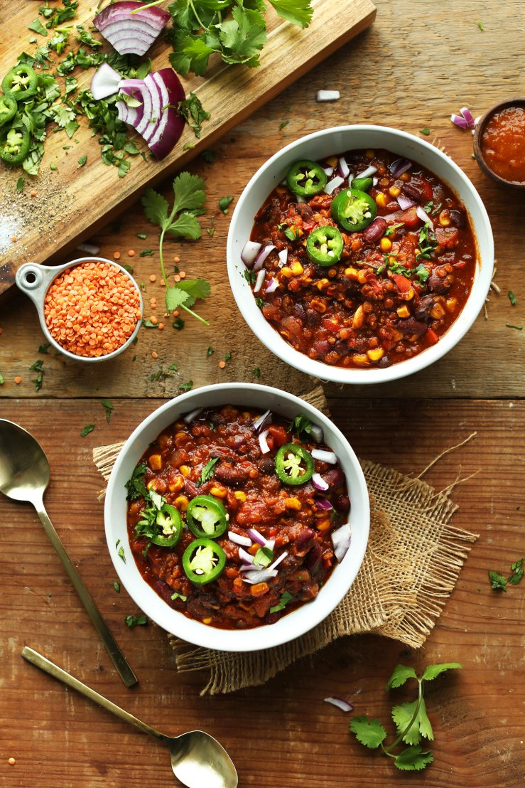 Two bowls of our Lentil and Black Bean Chili for a protein- and fiber-packed vegan meal