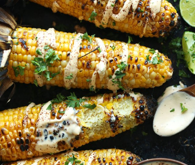 Summer Vegetable Recipe Of Mexican Grilled Corn Drizzled With Sriracha Aioli