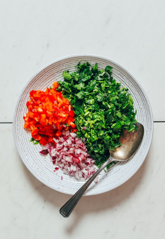 Bowl of parsley, bell pepper, and red onion