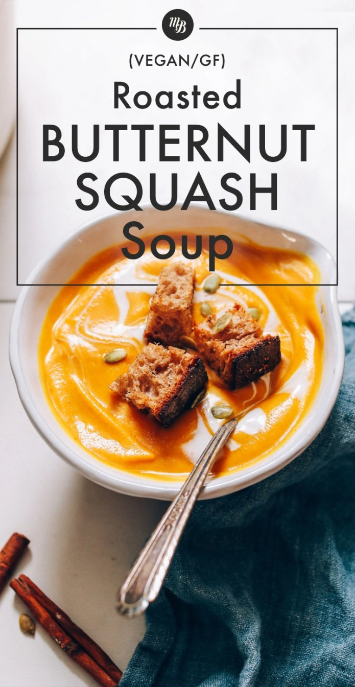 Bowl of butternut squash soup topped with homemade croutons and pepitas