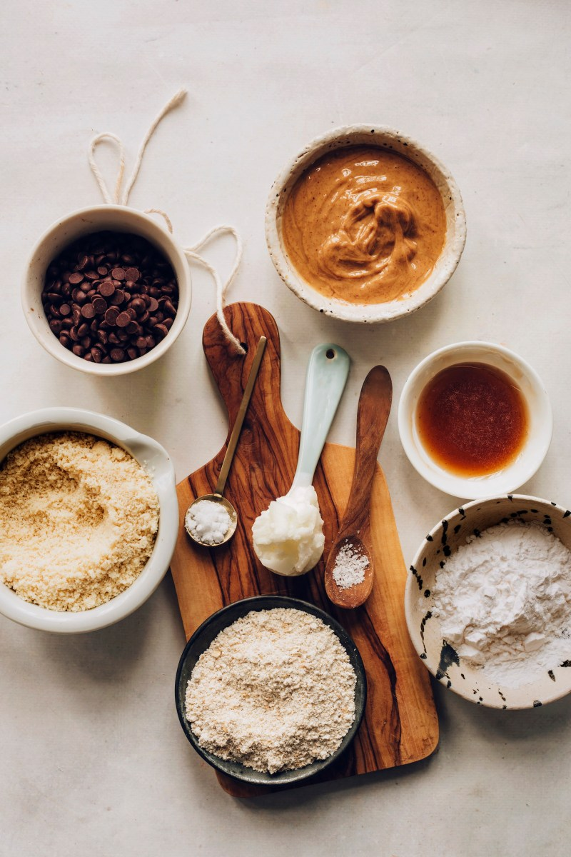 Chocolate chips, peanut butter, maple syrup, tapioca flour, oat flour, almond flour, coconut oil, baking soda, and sea salt