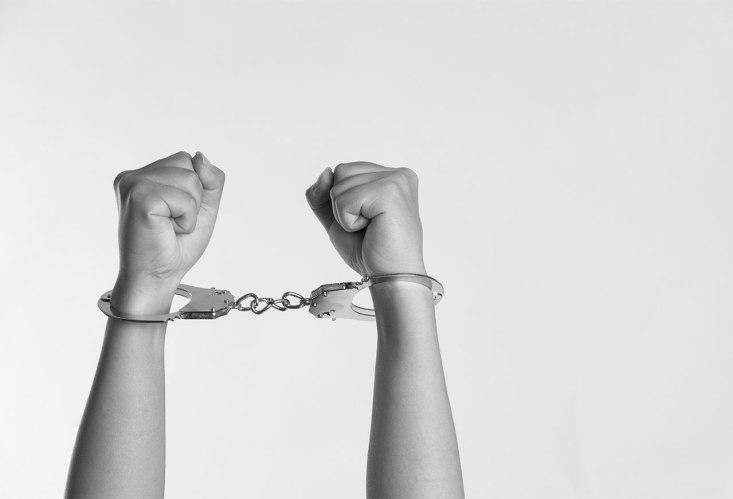 slavery handcuffed man