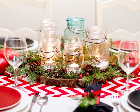 glass jars candles and branches christmas table centerpiece