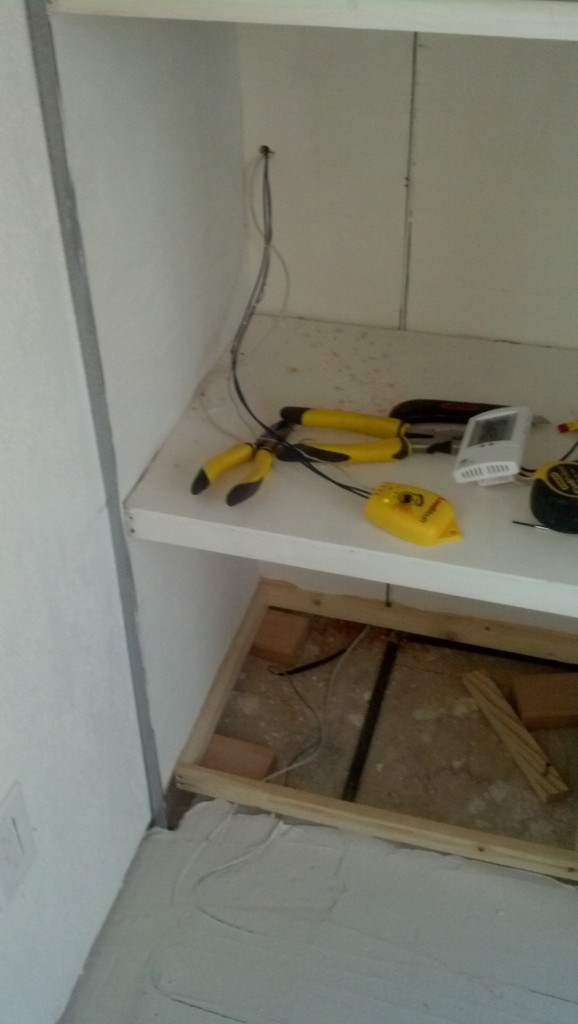 Here is a picture of what I forgot to post before, the wires from the heat wire exit out of the building into the electrical closet (on the back side of the dresser unit, accessible from outside) they will attached to power out there like the rest of the stuff in the house except to their own independant breaker box and then the controls enter back in the house and I will be able to easily control the heat from a thermostat