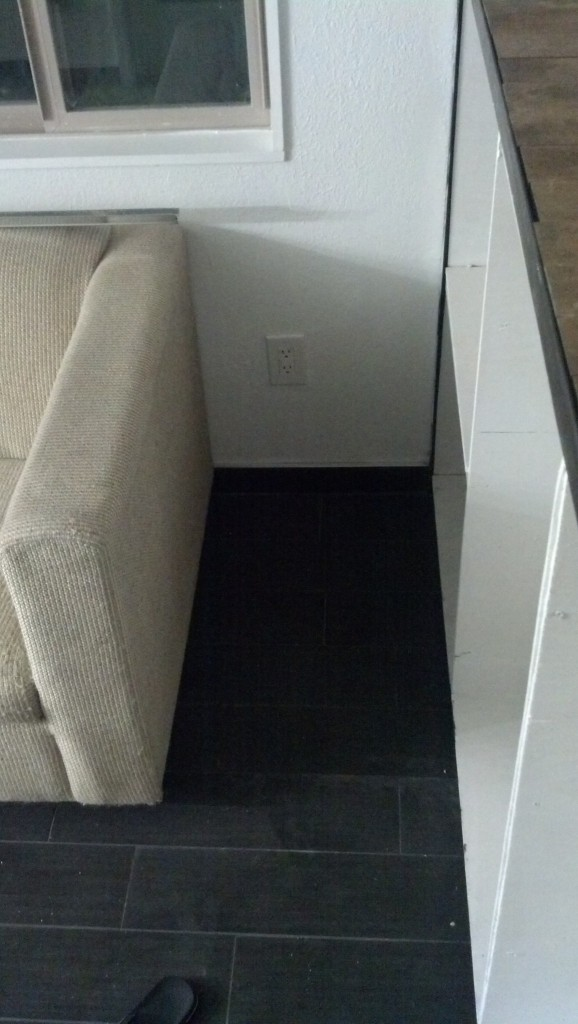 This is the space to the side of the couch,