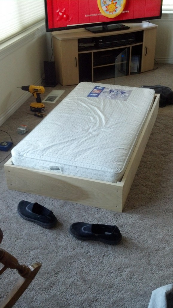 The base of the co-sleeper is in, the mattress is elevated.
