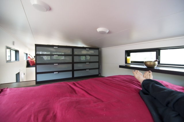 This remindes me of my bed area but a bit more private by having the storage there,  Love the window details too, nice shelving area that is great for setting a glass of wine on, not that I drink in bed... or at all for the last 9 months!  :)