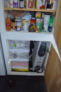 and below the pantry, this is where the supplemental heater goes and all the cloth diapers