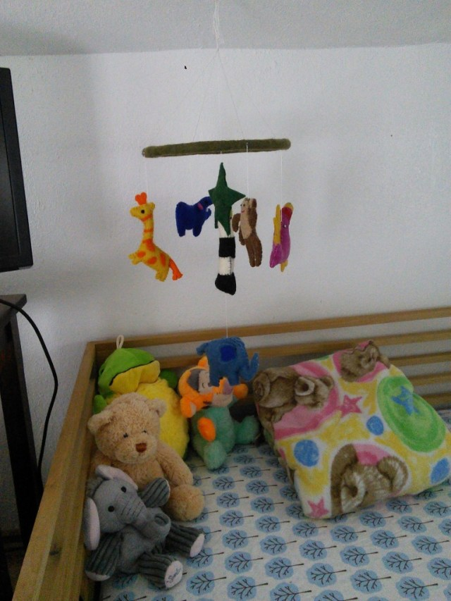 And she has a neato locally built mobile at the end of her bed.  I had it over her bed until I laied down under it and its just color blobs spinning, from under you can't see the animals, I moved it to the end of the bed and she likes it better :)