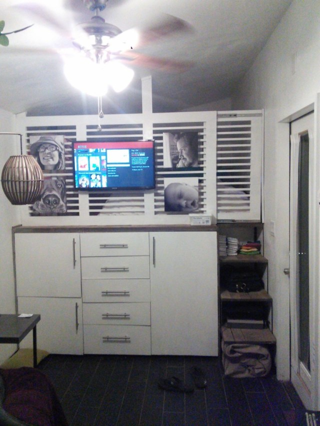 I moved my tv and mounted it on this wall, along with some family photos.  The gate is hug with some heavy duty drawer rollers