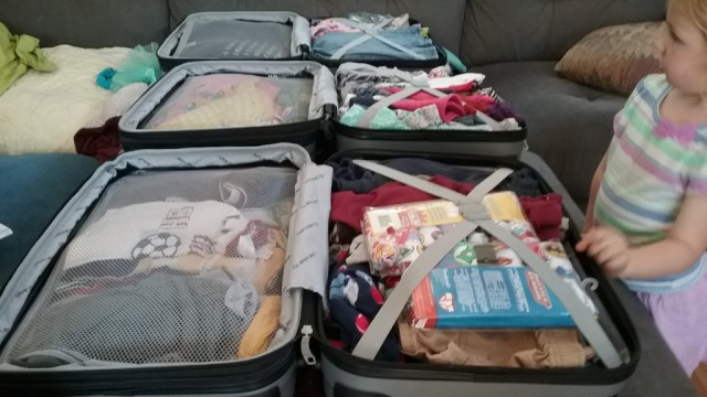 clothes are packed.  three peoples clothes for a year.