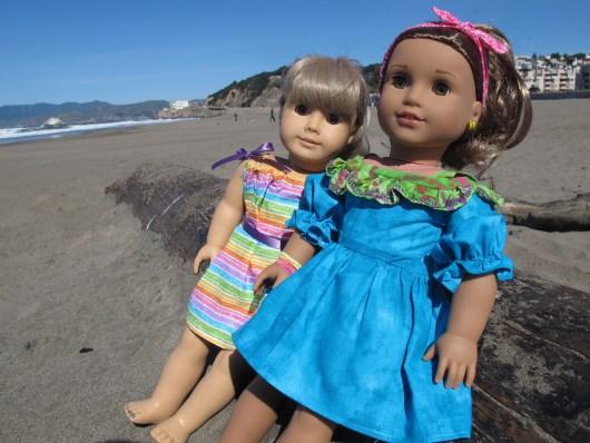 American Girl dolls in handmade dresses