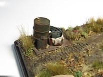 Barrel, jerrycan and ammunition