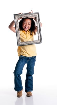 Girl holding picture frame