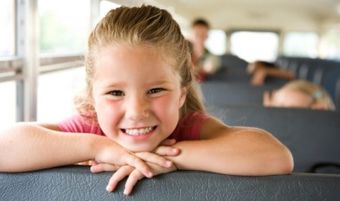 Girl riding on school bus