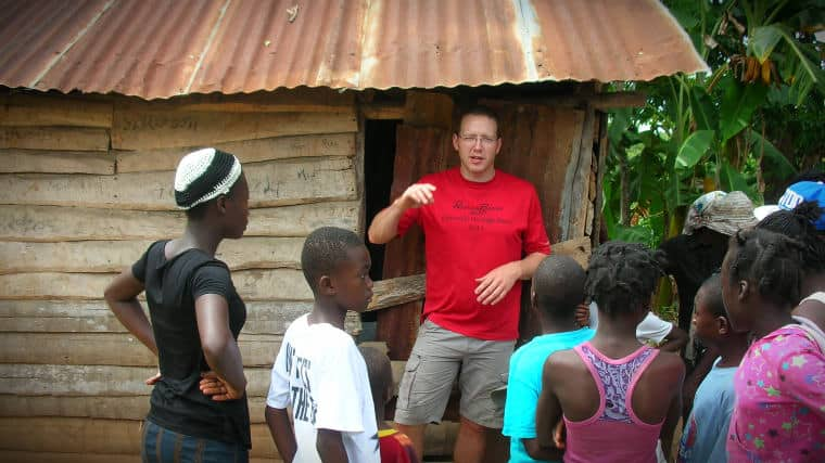 Tony Kummer talking to a group of young people in Haiti