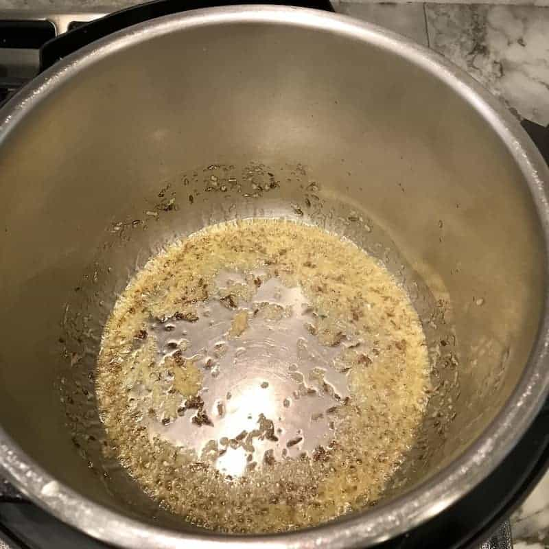 Instant Pot with ghee, cumin seeds and ginger