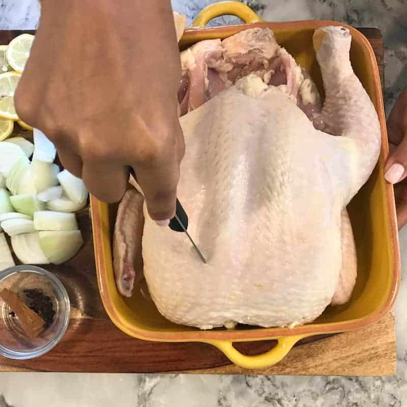 Make slits on the chicken with a knife