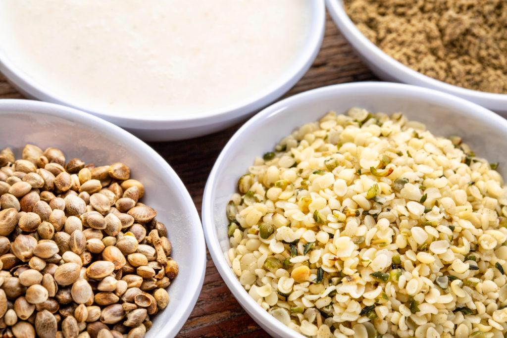 Today, hemp foods are widely available in grocery stores, from hemp hearts to hemp protein powder. Photo: Four different forms of hemp food in bowls, including hemp seeds, hemp hearts, hemp milk and hemp protein powder.