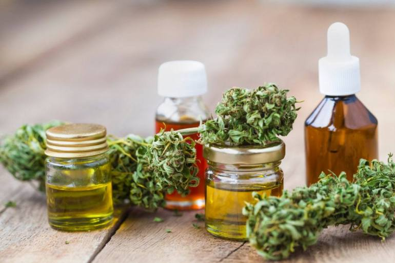 We took a closer look at CBD bioavailability for three popular ways to take this supplement. Photo: A collection of CBD oil bottles of different sizes & shapes, decorated with hemp flower buds.