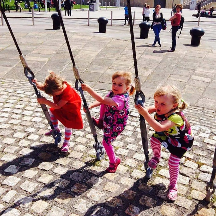 three little girls climbing. day-trip-to-liverpool-with-kids-2 www.minitravellers.co.uk