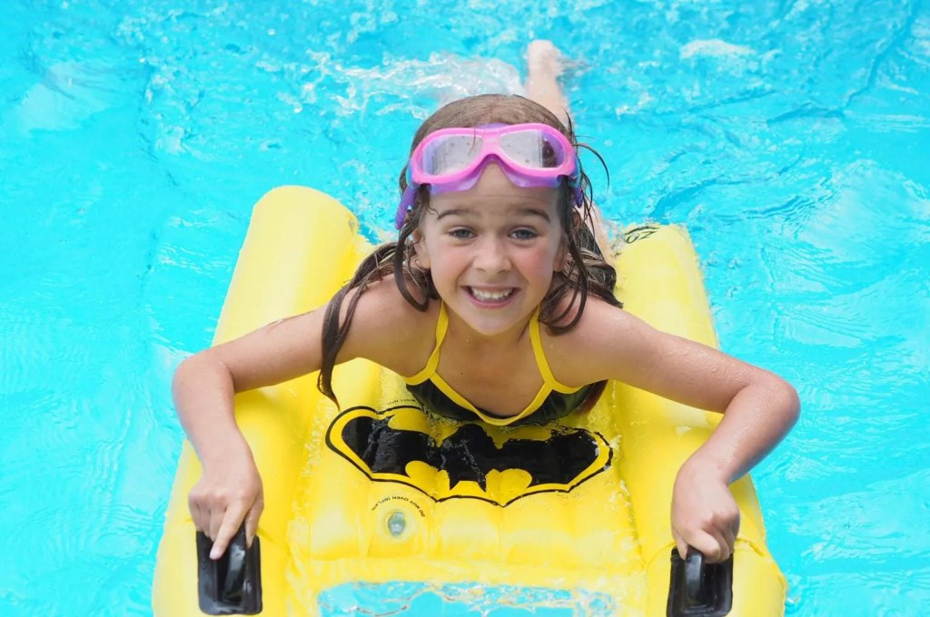 Child wearing DC Super Heroes Swimwear from Zoggs - a great thing to pack in your 'always ready' beach bag