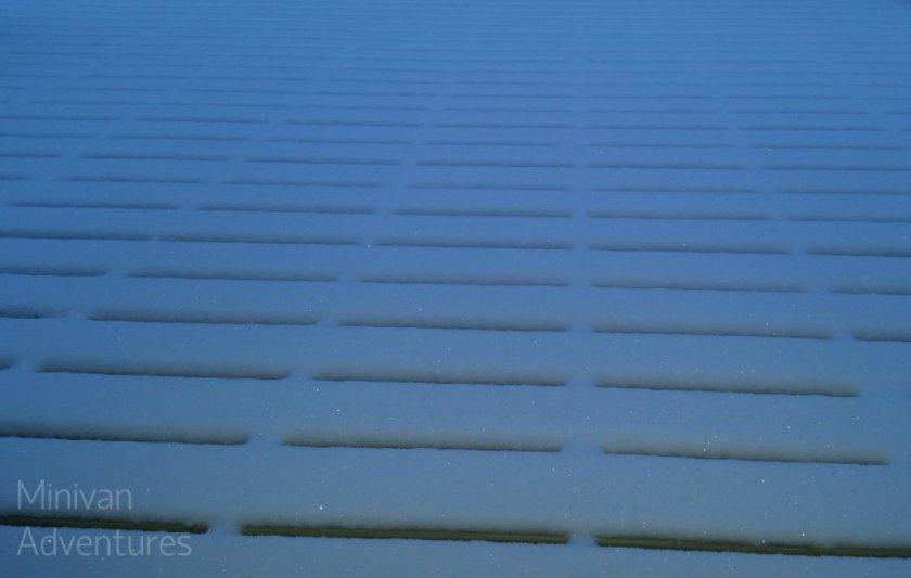 Our deck boards create a pretty pattern out of newly fallen snow in the early hours of the morning.