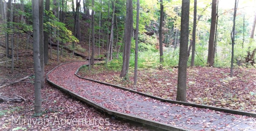 Thatcher Park in Ravenna, Michigan is filled with fun surprises – a giant hillside slide, secret woodland trails, an adorable playground, a waterwheel, and picturesque views. Plus it's less than two miles from the Musketawa Trail! You won't want to miss this hidden gem in West Michigan! | Thatcher Park | Ravenna Michigan | Hillside Slide | Playground | Waterwheel | Crockery Creek | Musketawa Trail | West Michigan | United States