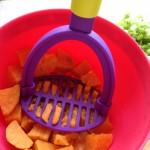 mashing up the sweet potato