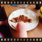spreading bean mix on tortilla